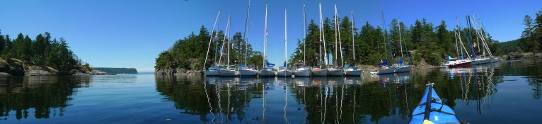 A panorama of row of yachts rafted up for the weekend at Smuggler Cove.